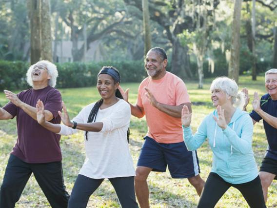 Group of older people exercising outdoors